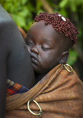 Bodi Tribe Baby Asleep With Coffee Bean Hairstyle, Hana Mursi, Omo Valley, Ethiopia (Eric Lafforgue) Tags: africa sleeping portrait people baby color art love coffee beauty vertical proud outside photography back clothing colorful day outdoor sleep traditional culture pride jewelry tribal bean ornament omovalley tradition ethiopia tribe comfort pastoral motherhood ethnic protection groupofpeople bodymodification jewel carrying determination coffeebean hornofafrica ethnology bodi omo eastafrica traditionalclothing realpeople colorimage beautify meen waistup africanethnicity pastoralist pastoralism snnpr bodytransformation southernnationsnationalitiesandpeoplesregion ethiopianethnicity hanamursi coffeebeanhairstyle eth7695