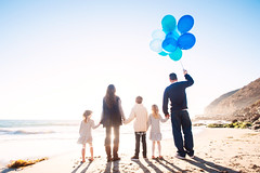 Up, Up and Away! (Extra Medium) Tags: ocean family boy beach girl balloons children mom twins sand dad father mother husband malibu wife familyphotographer balloonbouquet nikond700 venturacountyfamilyphotographer