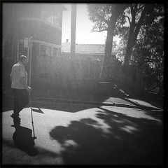Sydney suburban - the old fella who's always tellin' you stories for ya own good. (Albion 'a whole lotta busy' Harrison-Naish) Tags: street light shadow blackandwhite man monochrome square candid sydney australia squareformat nsw newsouthwales lightandshadow glebe hipstamatic blackeyssupergrainfilm streetphotogoraphy janelens