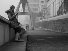 under construction // hamburg, germany (pamela ross) Tags: city pen germany harbour crane hamburg helmet streetphotography olympus cranes worker underconstruction speicherstadt elbe gumboots hafencity ep1 elbphilharmonie streettogs
