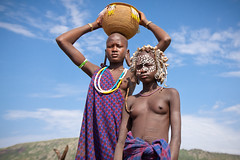 Mursi young women in the Mago national park. Ethiopia (NeSlaB .) Tags: poverty africa travel decorations portrait woman black girl beauty look hat canon painting photo necklace eyes women traditional country culture photojournalism tribal bodypaint clothes ornaments tradition ethiopia tribe ethnic society scar mursi scarification developingcountries reportage nationalgeographic coiffure afrique ethnography ethnology omo etiopia debub ethnies snnpr murzu neslab davidecomelli