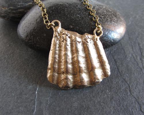 Cast bronze broken shell pendant