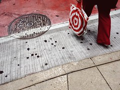 Chicago (mollyporter) Tags: street red bag concrete cover target manhole crosswalk gumdots