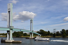Three Bridges and a Boat (Eddie C3) Tags: newyorkcity 103rdstreetfootbridge wardsislandbridge harlemriver bridges rivers triboroughbridge hellgatebridge ships boats robertfkennedybridge water sky