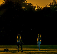 Girls'  long hair is caught by the setting sun at Charlton Lakes in Andover, Hampshire (Anguskirk) Tags: water charltonlakes girls hampshire silhouette summerevening trees uk wildlife settingsun andover hair rimlight
