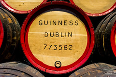 Guiness Dulin Red Rimmed Barrel (HunterBliss) Tags: barrel beer brand burned city close closed culture detail dublin etched europe european factory guiness ireland irish laying monument multiple name paint production red rim side storage stored storehouse texture together tourism tourist travel valve wood