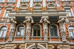 2016 - Baltic Cruise - Helsinki - A Heavy Burden (Ted's photos - For Me & You) Tags: 2016 cropped tedmcgrath tedsphotos vignetting helsinki helsinkifinland finland gargoyles streetscene street building