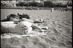 (Bikini Kill) (Robbie McIntosh) Tags: leicamp leica mp rangefinder streetphotography 35mm film pellicola analog analogue negative leicam analogico blackandwhite bw biancoenero bn monochrome argentique autaut dyi selfdeveloped filmisnotdead fomapan100 foma fomapan 100 stranger elmarit leicaelmarit28mmf28iii elmarit28mmf28iii 28mm arsimagofd beach summertime onthebeach lidomappatella mappatellabeach swimsuit bathers bikini girl ass booty people
