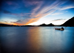 aftertones (helen sotiriadis) Tags: longexposure sunset sky lake seascape reflection silhouette clouds canon landscape boats twilight dusk greece bluehour loutraki canonefs1022mmf3545usm vouliagmeni canoneos40d