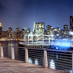 Gantry Plaza State Park (Rafakoy) Tags: park city nyc longexposure light urban ny newyork reflection building 120 6x6 tlr film skyline architecture night buildings mediumformat reflections dark square lights cityscape fuji slide 64 queens hunterspoint eastriver positive tungsten fujichrome e6 longislandcity 120mm 80mm unbuilding gantryplazastatepark unitednationsheadquarters t64 yashica12 yashinon80mmf35 fujit64 epsonv600 epsonperfectionv600photo