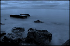The Dark Side (Gareth Priest) Tags: uk longexposure blue sea sky mist inspiration black cold beach water stone wales night clouds dark landscape nikon rocks experimental mood silent emotion creative cardiff surreal atmosphere tint eerie pebbles creepy spooky ethereal mysterious mystical feeling tones epic penarth atmospheric ambiance bristolchannel d5100