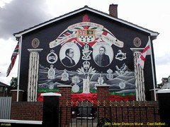 Royal Irish.- WW1 Memorial Mural in East Belfast, Northern Ireland. (mrvisk) Tags: soldiers british army forces old irish history cap badges red hand flags shamrock harp art painting stone wall helens tower union jack ulster battle war somme france emblems crown edward carson regiments men heros honour poppys military pic killaloe duty volunteers boots professional courage faughaballagh groupshot mrvisk 1910s people outdoor infantry street proud attraction