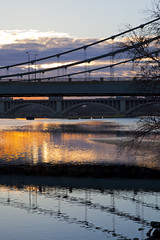 bridges over the mississippi - Minneapolis Minnesota (Lucie Maru) Tags: bridge pink blue urban usa cloud sun reflection water minnesota clouds sunrise mississippi midwest minneapolis reflect
