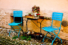 Blue Chairs (VivianaSantini) Tags: travel flowers blue summer streets table switzerland alley nikon europe pretty d70 chairs stones gorgeous rusty bluechairs