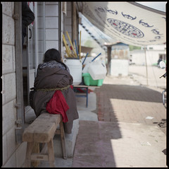 "sitting red waiting (beetabonk) Tags: china 120 6x6 mediumformat square tibetan xiahe 中国 gansu autonomous hasselblad500cm 甘肃 夏河 fujipro160s prefecture"" 甘南藏族自治州 བསང་ཆུ་ carlzeisstplanar2880cf ""gannan ཀན་ལྷོ་བོད་རིགས་རང་སྐྱོང་ཁུལ་ cnxhhb160s0611072"