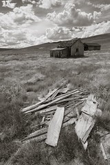 Lone Bodie cabin with clouds (Xiphoid8) Tags: old abandoned clouds decay debris rustic ghosttown bodie bodieghosttown monocounty abandonedtown bodiecalifornia blackwhitephotos bodieca goldtown monocountyca lonecabin bodiehouse loneshack bodecabin bodieshack