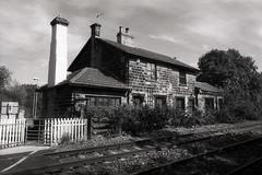 Railway Cottage (Saturated Imagery) Tags: urban blackandwhite iso100 cottage leeds tracks railway yellowfilter selfdeveloped methley luckyshd100 vivitar28mmf25 prakticatl5b rolleid74