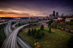 A Seattle Sunset (Michael Riffle) Tags: seattle city longexposure sunset urban skyline canon landscape photography washington downtown day cityscape northwest cloudy dusk safeco rushhour interstate safecofield roads olympicmountains joserizalbridge centurylink centurylinkfield