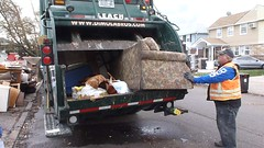 Crushing a couch destroyed in hurricane Sandy NY (The Trash it Man) Tags: hurricane cleanup howardbeach hurricanecleanup flooddamagecleanup hurricanesandy sandyaftermath