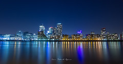 Canary Wharf, London, UK (byrne_photography) Tags: city uk longexposure blue england sky reflection water beautiful architecture canon landscape lights cityscape nightscape nighttime le bluehour dslr canarywharf canon550d