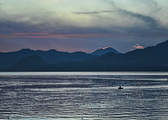 Photo of the Day: December 3, 2012 (Doug Murray (borderfilms)) Tags: borderfilms dougmurrayproductions pod photooftheday december32012 sanpedrolalaguna lakeatitlan lagoatitlan morning dawn sunrise red ring volcano fishermen water lake boat early predawn tranquil peaceful quiet