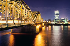 Cologne from the other Side (_flowtation) Tags: longexposure bridge winter light sky reflection church water night reflections river lights nikon european cathedral nacht bokeh dom aviation kirche safety binoculars agency bluehour fluss rhine rhein lichter rhineriver klnerdom blauestunde klnarena spiegelungen hohenzollernbrcke hohenzollernbridge bokehlicious colognearena cathedralkln nikon2470mm nikon247028 nikon2470mmf28 d7000 lanxessarena bokeeeeeeh nikond7000 cathedralcolone europeanaviationsafetyagency europischeagenturfrflugsicherung