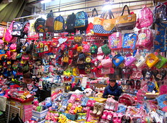 """Korea Daegu Somun market tons of colorful bags for sale - """"Take Your Pick"""" (moreska) Tags: birds shopping colorful asia cheery bright market korea goods angry characters bags goodies catchy logos clutter piles rok stands stacks daegu browsing muddle somun pororo cheapstuff"""