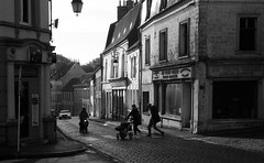 Crossing in Montreuil sur Mer (robmcrorie) Tags: montreuil sur mer france north nord 62170 pedestrian crossing car moped baby walker leica m2 film black shire fp 35mm