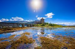 Eilean Donan Castle (Michael Watson Photography) Tags: scotland castle eilean donan loch sky blue water sea rocks bridge flag