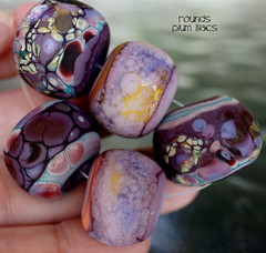 Rounds Plum Lilacs (Laura Blanck Openstudio) Tags: openstudio openstudiobeads set jewelry glass handmade lampwork beads bead murano opaque matte frosted glow etched whimsical funky odd round donut abstract asymmetric organic earthy colorful multicolor speckles made usa raku frit artisan artist fine arts art kiln annealed grape plum mauve lilac lavender violet purple enamels green copper mango coral orange