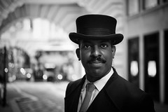 Doorman (Foto John) Tags: leicam240 leicam leica leicamtyp240 rangefinder summicronm50mm2iv blackwhite blackandwhite blackandwhitethatsright monochrome streetphotography man doorman friendly character hat london uk