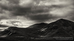 Brooding (andrew benham) Tags: glencoe scotland sky highlands mountains skyline mono sepia moody dark low key black white nature country barren brooding stob glais choire buachaille etiv mor