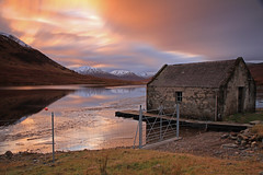Loch A' Bhraoin. (Gordie Broon.) Tags: longexposure winter sunset mountains ice nature water clouds fence reflections landscape geotagged photography scotland scenery gate alba scenic escocia hills snowcapped explore boathouse schottland westerross ecosse scottishhighlands braemore dundonnell lochabhraoin canoneos7d gordiebroon fainbridge