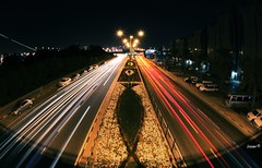 Midnight Traffic (Jaser Alagha) Tags: bridge winter light cars canon lens lights airport long exposure december traffic wide fisheye corniche midnight 5d 2012 doha qatar   cornich   jaseralagha