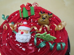 Christmas Cake (shaire productions) Tags: santa christmas xmas red food holiday festive season reindeer dessert photography design foods photo ribbons pattern image market sweet decorative seasonal decoration cream picture pic desserts plastic celebration delicious photograph gift pastry ribbon ornamental decor edible imagery holidayseason
