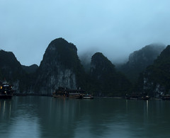 Night Descends on Ha Long (William J H Leonard) Tags: ocean winter sea cliff mist seascape water misty clouds landscape asian boats island islands bay boat junk rocks asia southeastasia vietnamese ship cloudy foggy cliffs vietnam limestone halong halongbay rockformation southeastasian northernvietnam limestonerocks gulfoftonkin limestonecliffs