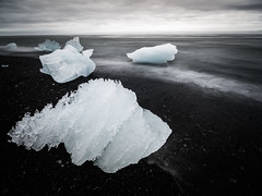 Jkulsrln 08 (arsamie) Tags: jokulsarlon iceland black white beach ice cube iceberg water snow solid sea ocean atlantic wave long exposure north cold epic myth liquid