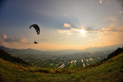 Flying  (Vincent_Ting) Tags:    taiwan clouds light sky seaofclouds blue  sunrise     foggy  sunset  city vincentting gettyimages  paraglider paragliding