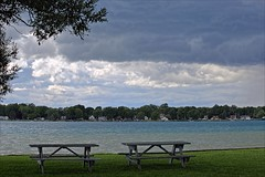 Goodbye Thunder Island (Sue's Photo) (Daryll90ca) Tags: clouds stormclouds picnictable river