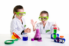 Whoa! (tltichy) Tags: backtoschool beaker blue coat experiement foam foaming girls glasses goggles green highkey kids lab learning magnifyingglass measuringcup primaryscience purple red safety science surprised test tube tweezers white