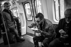 eating in the tube (Jack_from_Paris) Tags: r0001865bw ricoh gr apsc capture nx2 lr monochrom noiretblanc street london uk manger eat djeuner regards eyes hommes men tube mtro londres londonien