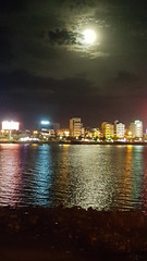 Clouded moon (Roving I) Tags: moon nature nightsky cloud reflections water hanriver nightscapes danang vertical vietnam