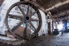 Wheel (Skier1437) Tags: canon abandoned urbex urban exploration eastcoast decay urbandecay mill buildling textile textilemill fabric sheets sheet industry abandonedindustry factory industrialrevolution industrial iron metal wheel spokes heavy rope