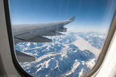 Snow-covered Alps from airplane window (Joel Carillet) Tags: alps flying window mountains snowcovered snow rugged landscape sky blue winter travel locations wing view traveldestination europe germany austria