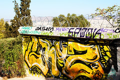 yellow wall (Katrinitsa) Tags: plaka athens greece anafiotika colors shadows canon  nature city cityscape architecture view graffiti cityview street fence yellow wallpainting wall shadow ef35mmf14lusm art