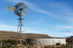 The Windmill And Water Tank in Sutherland (charissadescande) Tags: grass tank dry landscape sunset old water industry rural arid nature tanks wind environment irrigation pump land outdoors windmill dams sky farm outback drought energy field sutherland northerncape southafrica zaf