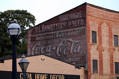 Faded Coca-Cola Mural (Phil Spell) Tags: canon usa maryland fredrickmd northamerica unitedstates building architecture sign text advertising cocacola bricks mural lamp streetlight tree sky hardwarestore americana
