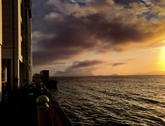 Evening in Alesund (e-box 65) Tags: alesund mreogromsdal norwegen no lesund sunset sonnenuntergang sea fjord norge norway meer sun clouds sky himmel wolken sunnmre abend evening abendstimmung