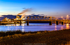 Vibrant-River-Bridge-Tacoma-HDR (Rob Green - SmokingPit.com) Tags: port tacoma maritime blue hour dusk sunset sun set setting water river puyallup west rock company mill sawdust plywood vibrant colors wa washington slow shutter speed long exposure sky purple reflections canon 7d mark ii 50mm fantastic plastic f18 rob green waterway shipping fishing tribal tribe grass path gravel road night east 11th street bridge trellace span historic old lights city cityscape steam clouds hdr tonemapping tone mapped photomatix