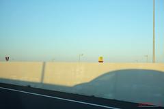 Fast Food from the Freeway.. (Kent Johnson) Tags: 1600logoadjsev1f7269 brisbane macdonalds freeway sky kfc fastfood freewaydriving shadow lightpoles concrete blue lateafternoon fujifilmxt1 xf35mmf14r industriallandscape australia